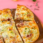 TARTE FLAMBÉE - French bacon and onion tart with Brie cheese.
