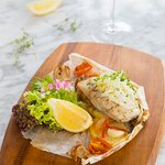 BARRAMUNDI EN PAPILLOTE - baked fish in a parcel with vegetables, black, Hawaiian salt, fresh herbs and lemon virgin olive oil.