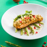 PISTACHIO-CRUSTED SALMON - served with grilled asparagus spears, Himalayan salt flakes, rocket salad and dill-caper cream.
