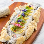 FRESH CATCH OF THE DAY - baked whole fish in a salt crust with lemongrass, kaffir lime and coriander served with steamed vegetables, spicy seafood sauce and steamed rice or steak fries.