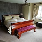 Luxurious Extra large King size bed. Walk in wardrobe Ensuite Large bay window over looking south view of garden Large window over looking West view of gardens. Seating area