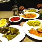 ilish paturi, chutney and prawn malaicury