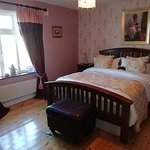 Luxurious King size Bedroom Bathroom Seating area Room view TV Wi Fi