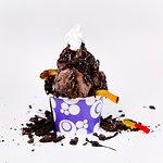 Build your own dirt sundae with Mucho Chocolato Frozen Yogurt, Oreos, and Gummy Worms!