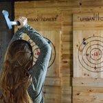 Girl throwing axes.