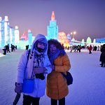 Harbin english speaking tour guide Samantha Song accomany with her clients at Habin ice and snow world, I have never left my client in Harbin ice and snow world alone, all Harbin Private Tour Guide asked must to follow our clients into all attractions.