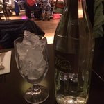 Carafe of water with posh glass of ice