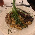 Blackened steak and shrimp on a bed of dirty rice