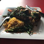 Half chicken, fire roasted in chimichurri sauce with Spanish saffron rice and green beans