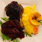 Duck leg with potatoes gratiné and beets.