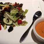 "Salad and ""Soup of the Moment"" (tomato lobster bisque), naturally gluten free."
