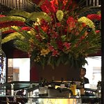 The salad bar topped with a beautiful floral display.