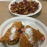 Strawberries and cream stuffed Challah french toast and corned beef hash.