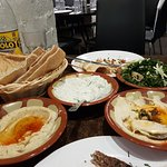 Entree - dips and bread. Dips were nice but I was concerned that the bread was delivered in a pl