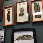 1 of the many sections of Costa Rican art on the walls. Hand painter feathers.