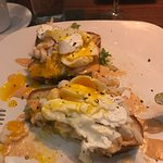 "Crab and ""avocado?"" toast with poached eggs added."