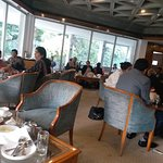 This is another picture of the ground floor lounge of the main building where visitors and members are enjoying lovely snacks with tea or coffee. Governor Amolak Rattan Kohli
