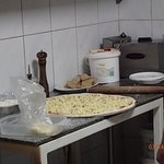Grande pizza in the making