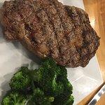 Ribeye steak with steamed broccoli