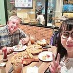Enjoying the pizza