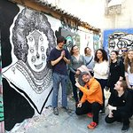 Posing with a graffiti artist and his work