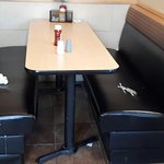 Torn seats, dirty tables and floor.