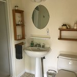 Hemlock Room Bathroom with Kohler Comfort Height Toilet and Shower Stall (Two person Jacuzzi in room alcove).