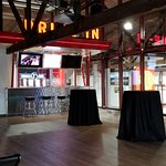 Event rentals have access to this fun bar, seating, and dining area on the second level