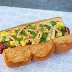 PINEAPPLE EXPRESS – bacon wrapped dog, bouillonnaise, sweet ginger glaze, pineapple, scallions, pickled jalapeños, crispy onions
