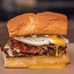 THE HANGOVER– white american cheese, smoked bacon, haus chili, fried egg, mayo