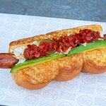 T-MEX – beef chorizo & pepper jack sausage, avocado, chipotle aioli, haus slaw, pickled jalapeños, pickled peppers