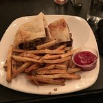 Philly cheesesteak sandwich with fries