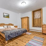 Pult or Apold is the name of our beloved village.  The room is spacious and perfect for two persons.   It has its own bathroom and TV and the mattress is extremely comfortable! There is a door which has a decorative role making you think that there is a new world wherever you go!