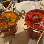 The butter chicken to the left, and my so called tikka masala to the left, which in reality is a