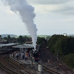 Steam train leaving Plymouth station.