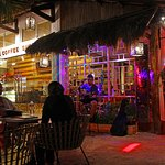 Outdoor Of The Cafe During Night Time With Live Acoustic Singer