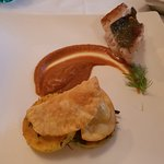 Fish fillet (half raw) on a reduction of fish brodetto, with crunchy sea-bass ravioli (too dry)