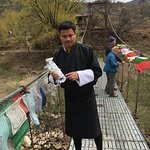 Our guide Sonam Tobgay blessing the prayer flags we hung on a bridge over the Tang River