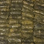 Our grape leaves are made from scratch & hand rolled!
