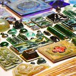 """A selection of Tiffany's pressed-glass """"jewels."""" Photo: Corey William Schneider"""