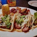 Pork Belly Tacos -  jicama, cilantro, avocado sauce, cilantro.