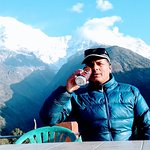 Drinking Gurkha beer with excellent view of Annapurna South & Himchuli at Chhomrong, Rooftop of Panorama guest house