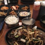 Sizzling Stone Pot Chicken Bibimbap $13.95, Beef Bulgogi $15.95 and platter of sides included fr