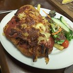 Chicken Parmi, chips and salad