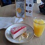 Strawberry-mousse cake (I think), orange-juice, and white-chocolate polar bears. All delicious.
