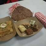 Meat pie, assorted desserts, falafel wrap