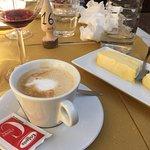 Delightful desert, coffee latte and vanilla ice cream.