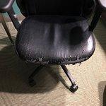 The desk chair has seen better days!