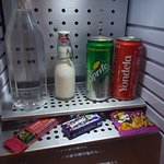 complimentary snacks and beverages in a mini fridge