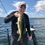 Big smiles and big Bass for Michael while fishing in Orlando!